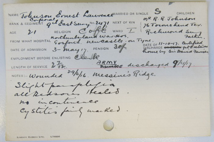 A paper patient record card, completed by hand, detailing his paraplegia and symptoms.